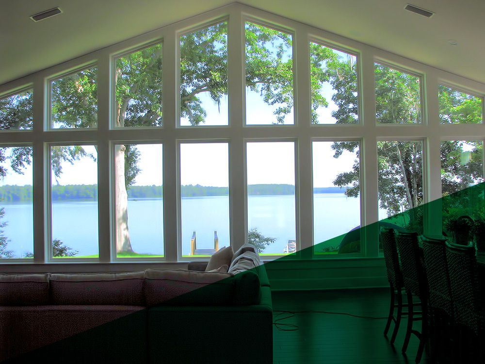 Back home addition with view of a lake