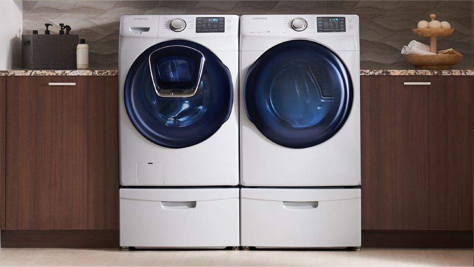samsung front-load washer and dryer in laundry room