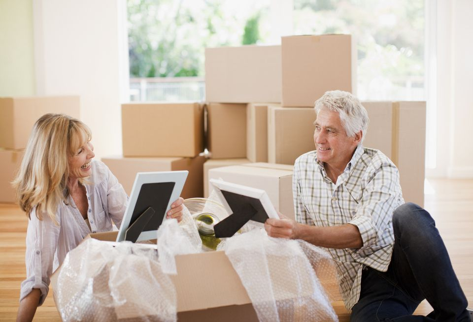 Couple unpacking pictures in a new house