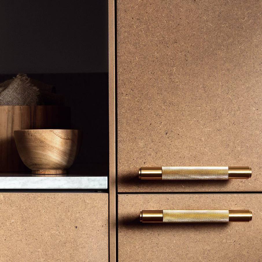 Gold and brass hardware on cork-like cabinets