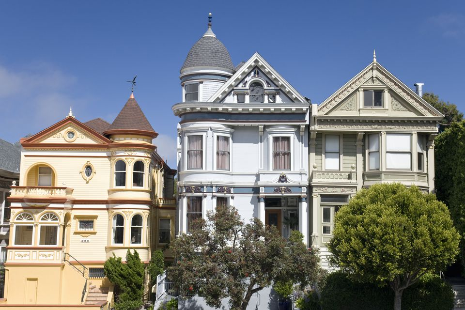 with gables and turrets, three brightly painted Victorian homes line the streets in San Francisco
