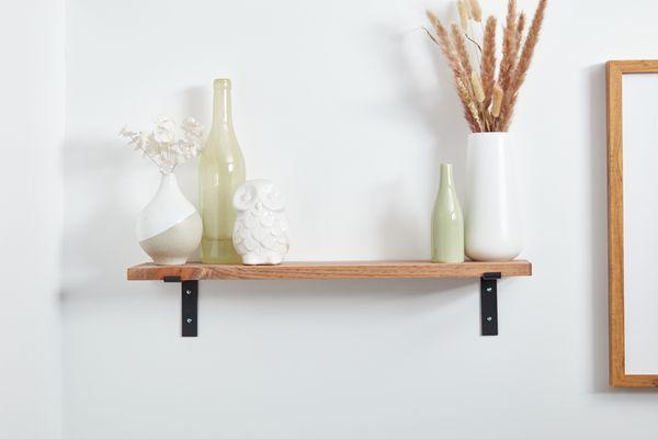 Vases on wall shelf