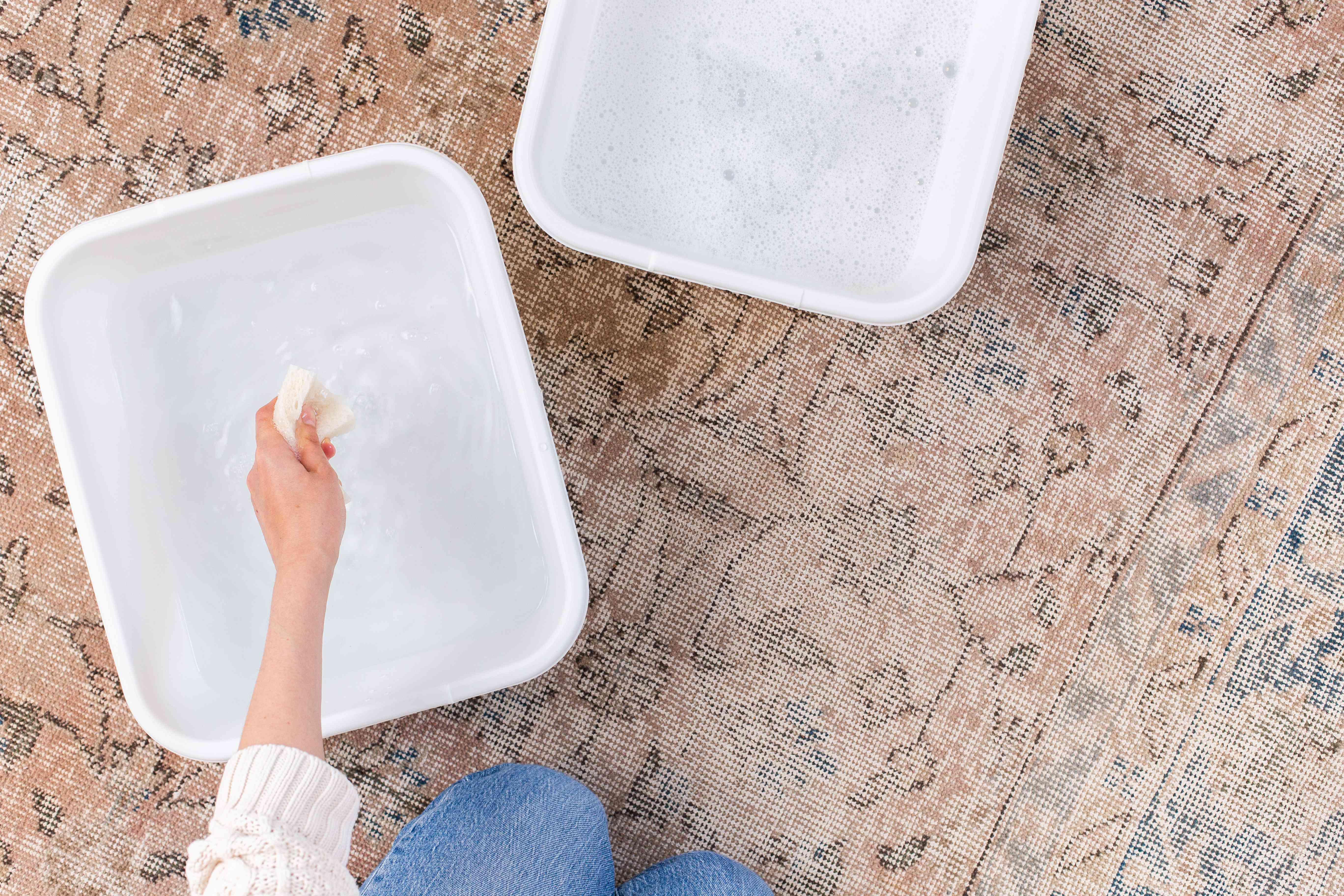 Sponge dipped in separate bucket of fresh water to rinse suds