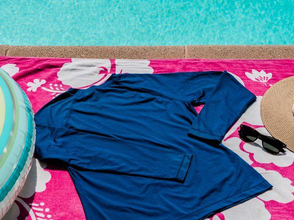 Rash guard on a beach towel