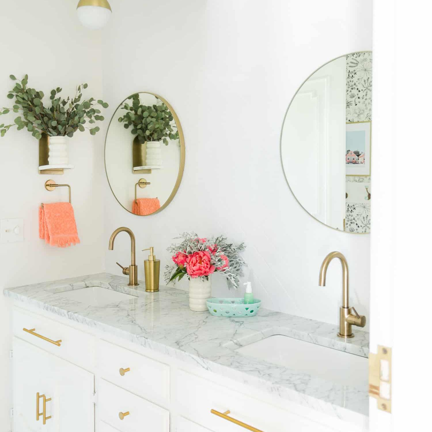 Bathroom with gold vanity and peach details