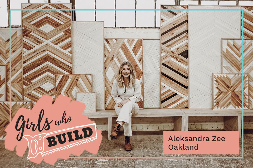 Aleksandra Zee poses with some of her wood panels for Girls Who Build