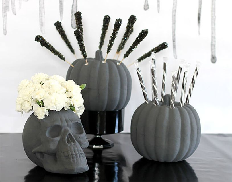 A black skull and pumpkins