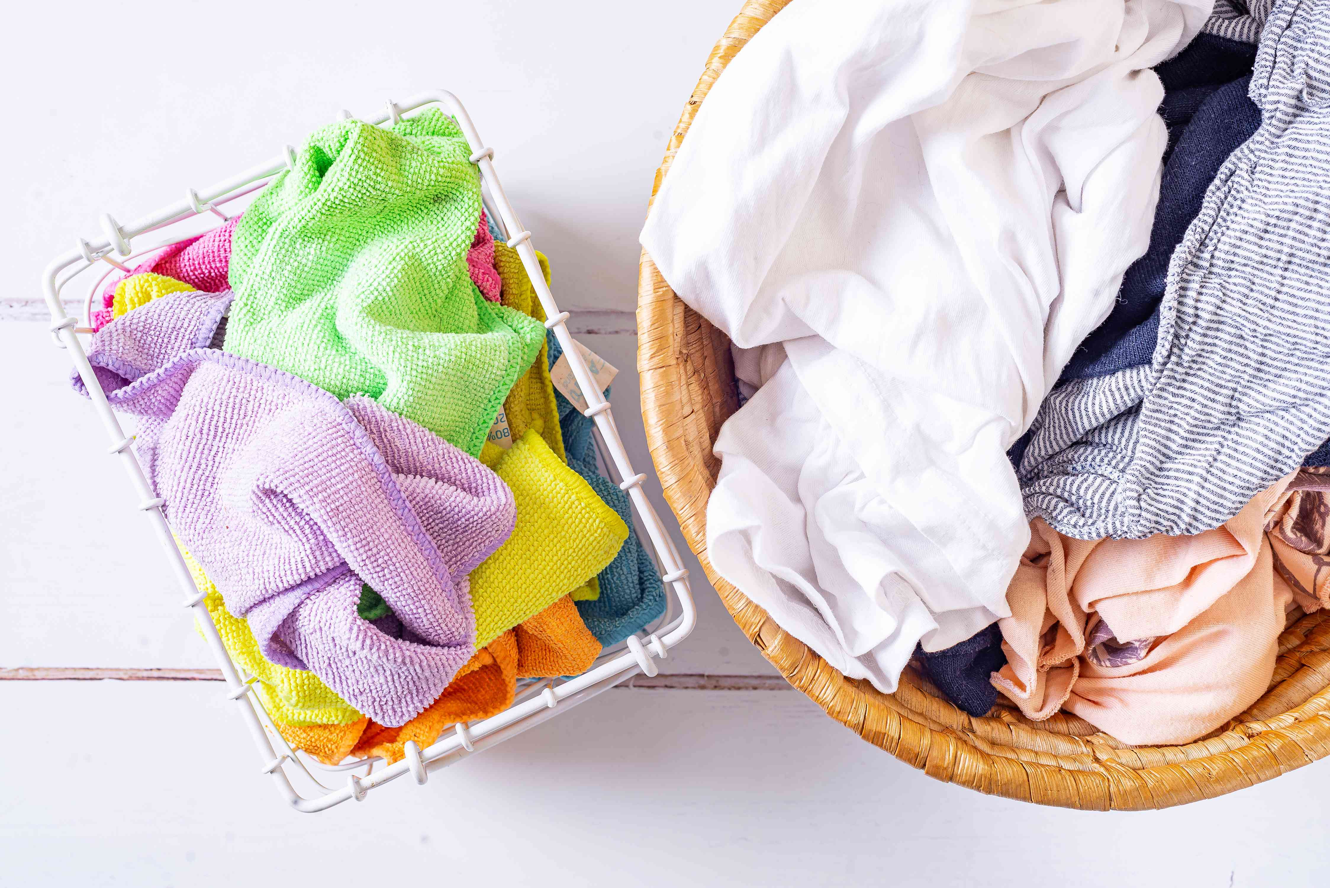 Microfiber cloths sorted out of laundry into white wired container