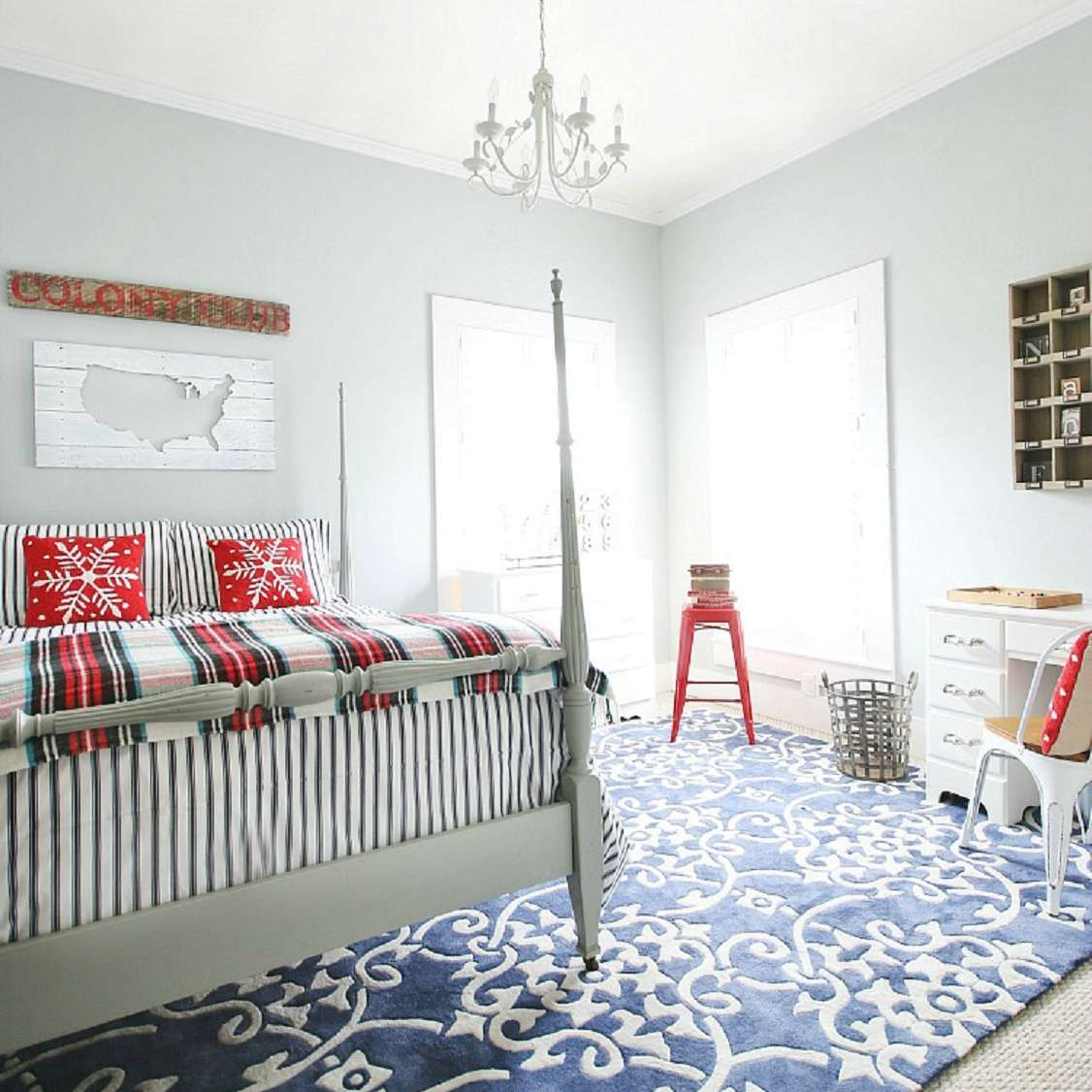 Red, white, and blue farmhouse bedroom