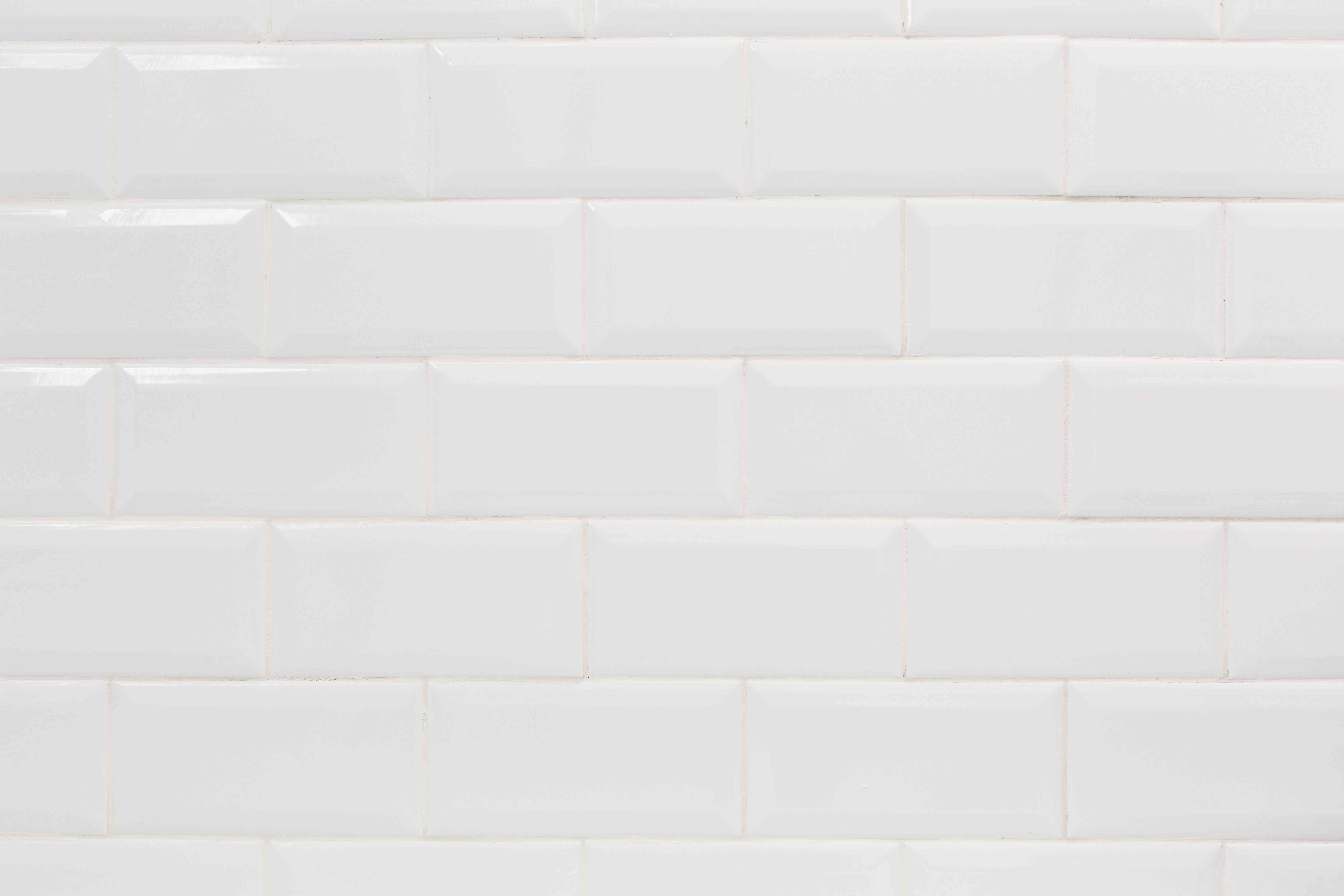 White ceramic wall tile buffed and completed