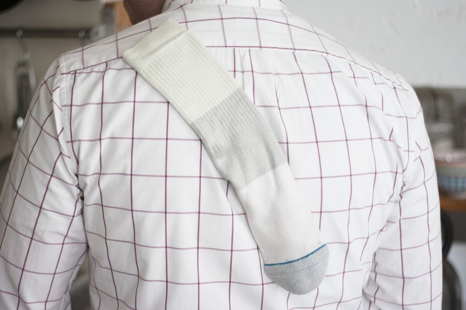 a sock sticking to a man's shirt