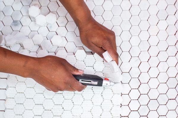 White mosaic tile installed with utility knife