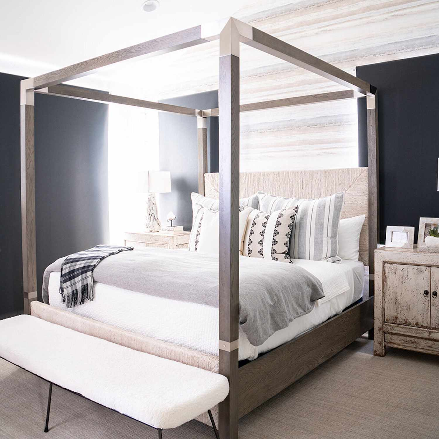 neutral gray color scheme bedroom with four post bed frame