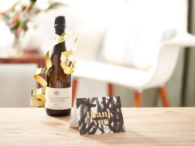 Thank you card and bottle of wine