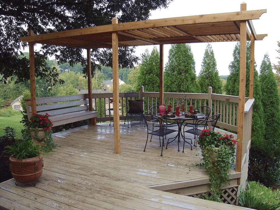 A backyard pergola with a deck.