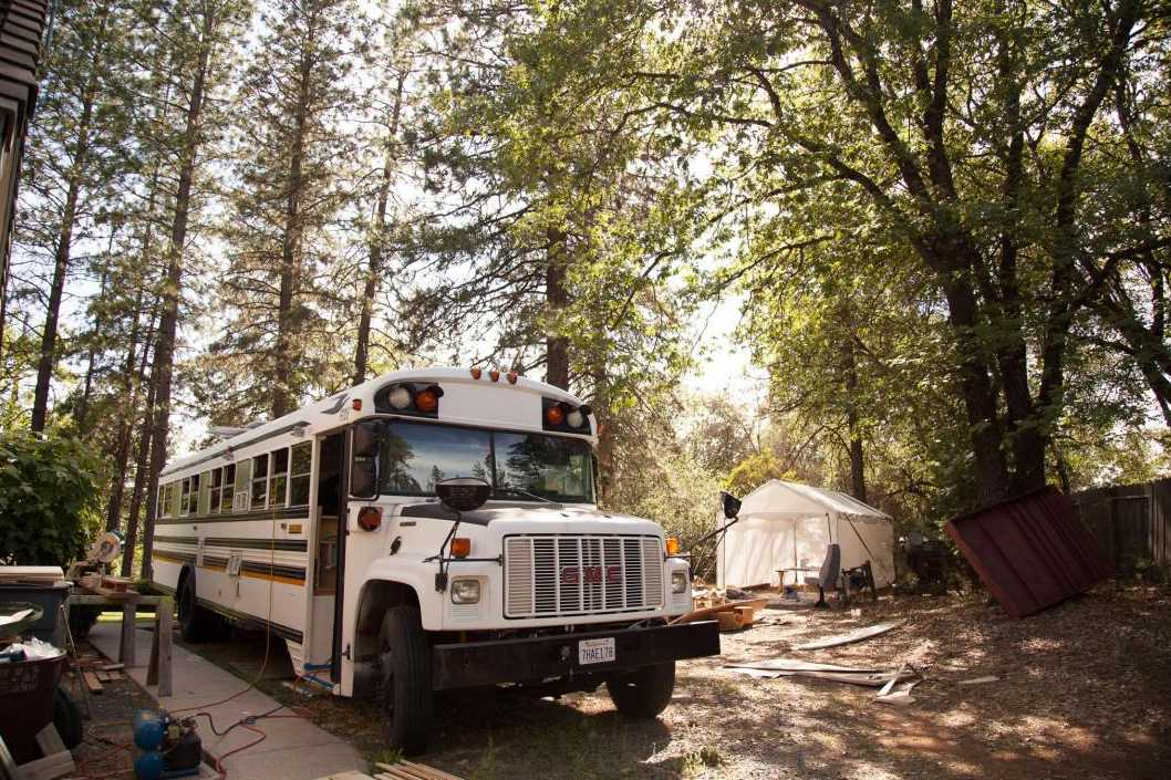 White bus at camp site