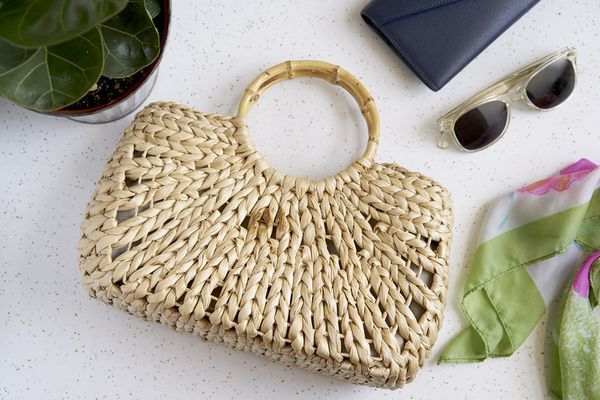 A stained straw handbag by other accessories