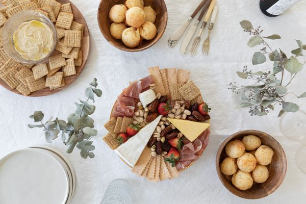 Party food laid out on decorative table with eucalyptus