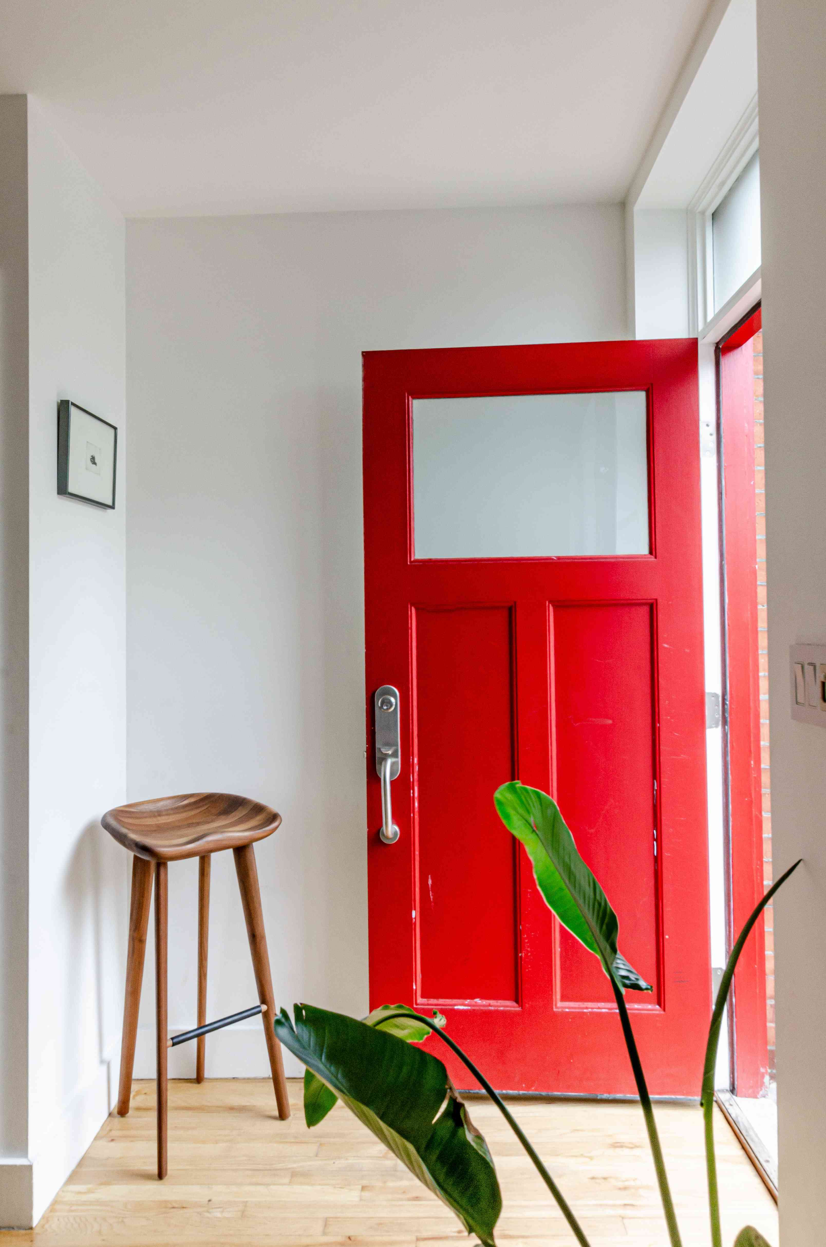 Red door on a townhouse entry.