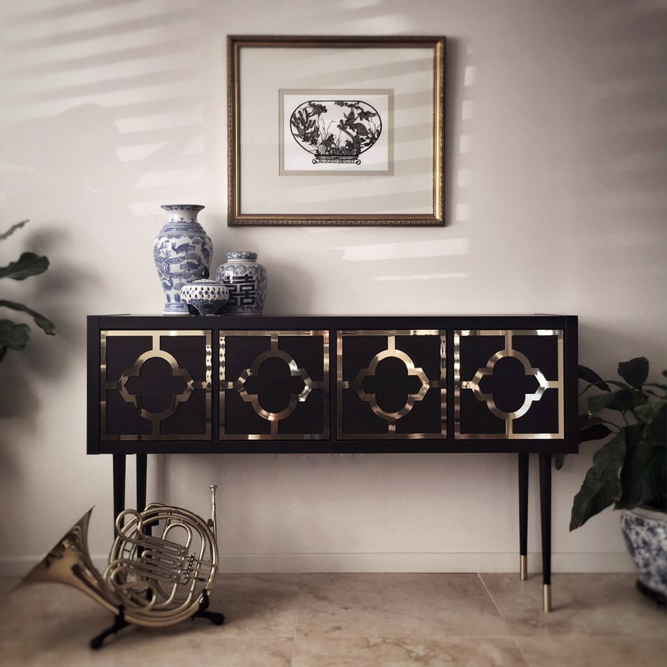 black and gold credenza made from a Kallax unit