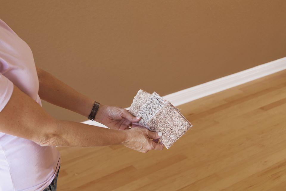Woman-choosing-carpet-color-samples.jpg