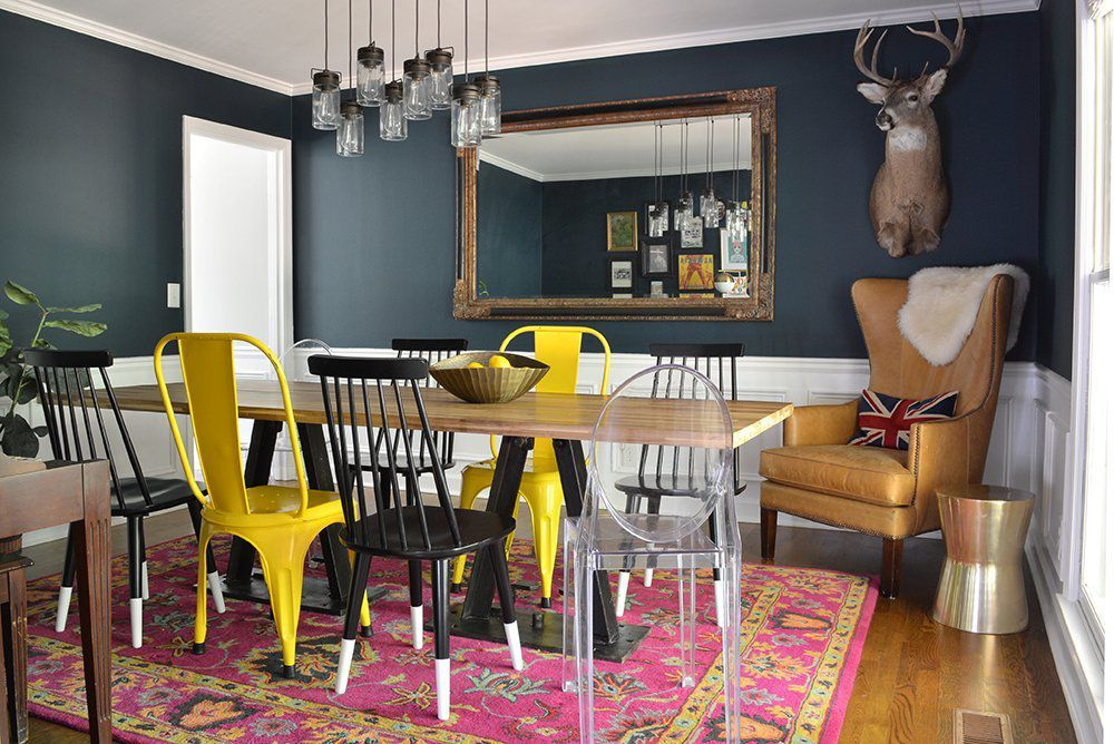 dining room with mixed styles of chairs