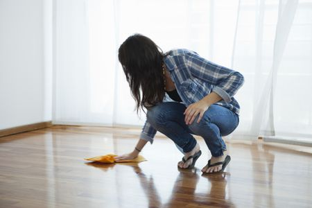 Woman Cleaning Wood Floors With Vinegar