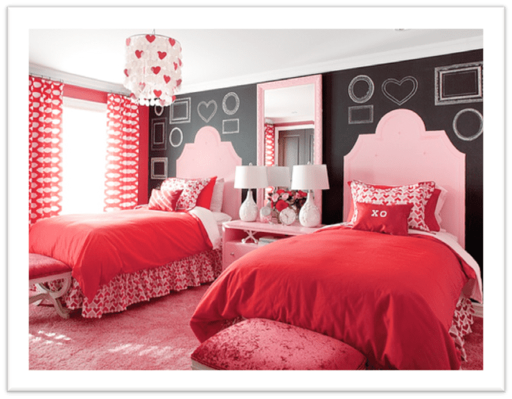 Pink and red girls' room with chalkboard accent wall