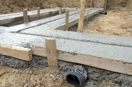 How to Pour Concrete Footings for Stone Walls