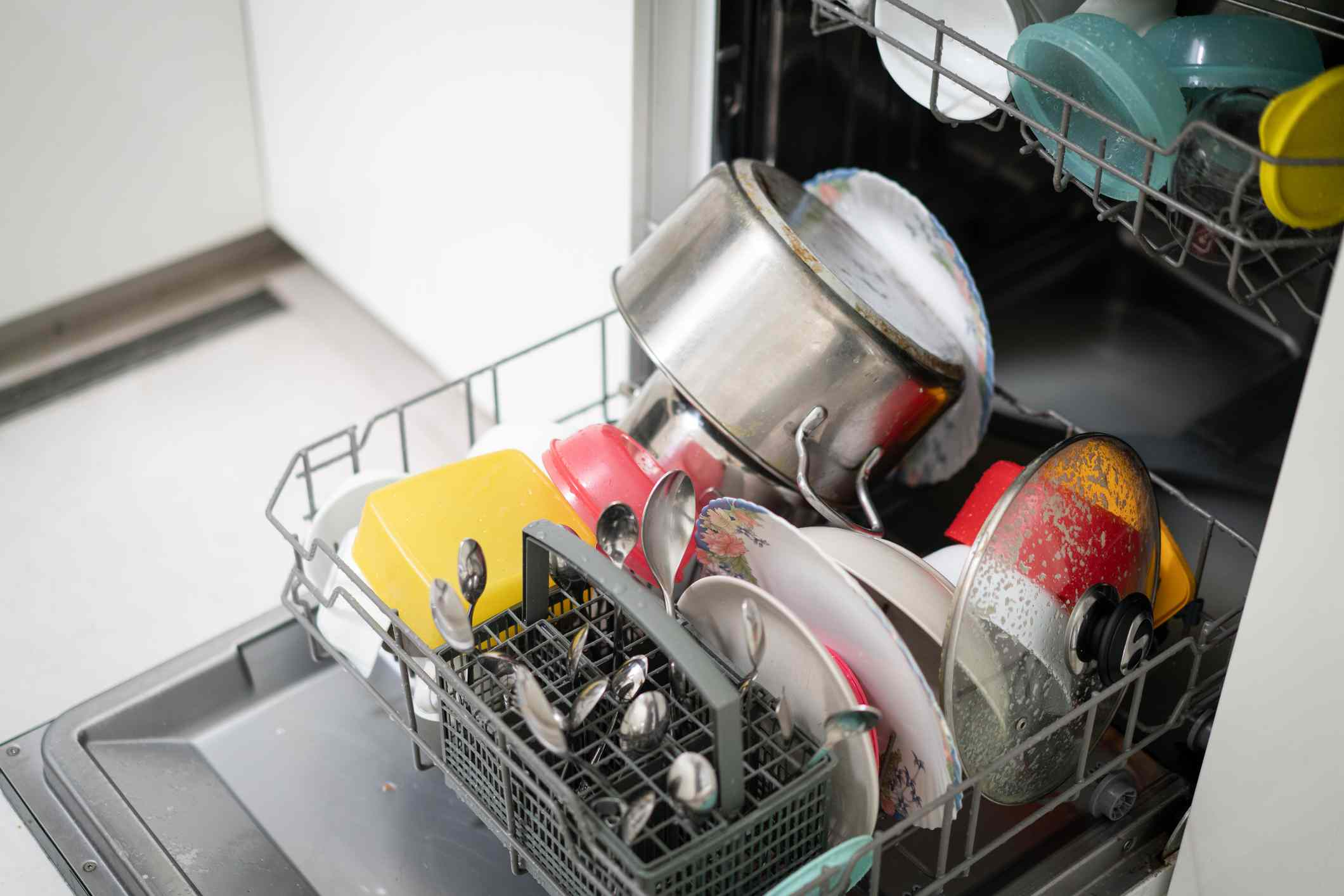 A dishwasher loaded with dishes