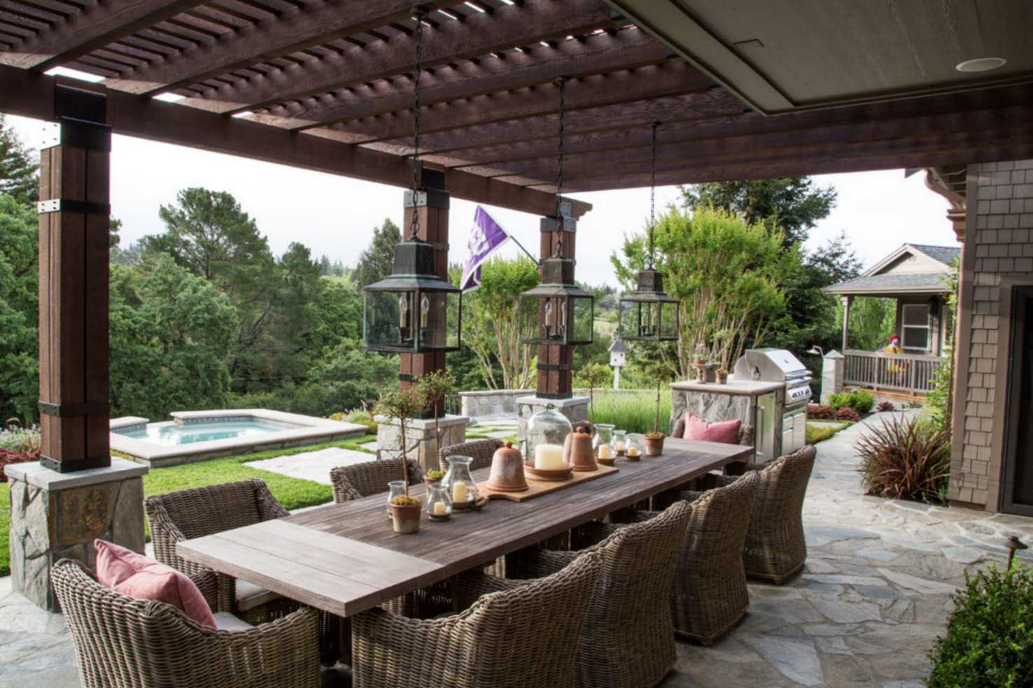 covered patio near pool with dinging room set and grill