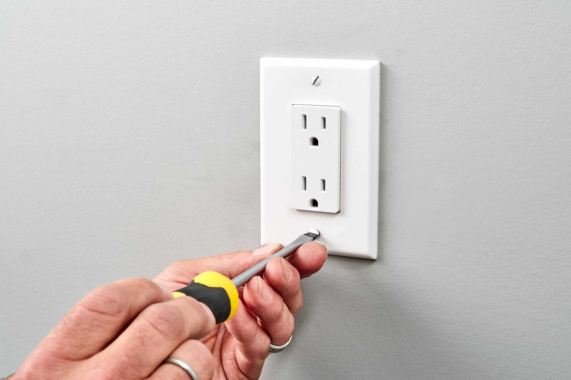 Warm outlet replaced with new outlet and secured with screwdriver