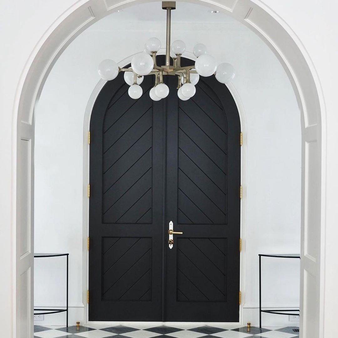 Black front door with top arch
