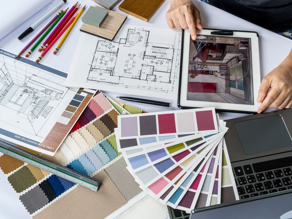 Architects/ interior designer hands working with tablet computer, material sample