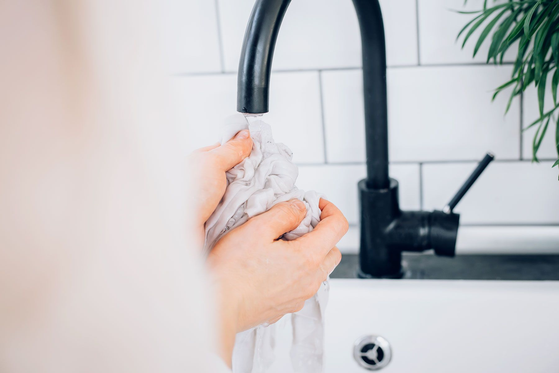 Rinse stain solution under water