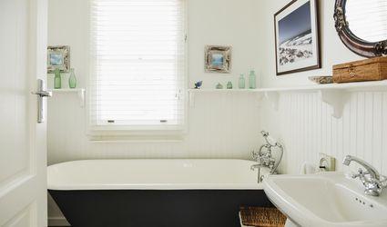 Claw-foot bathtub in an ornate bathroom.