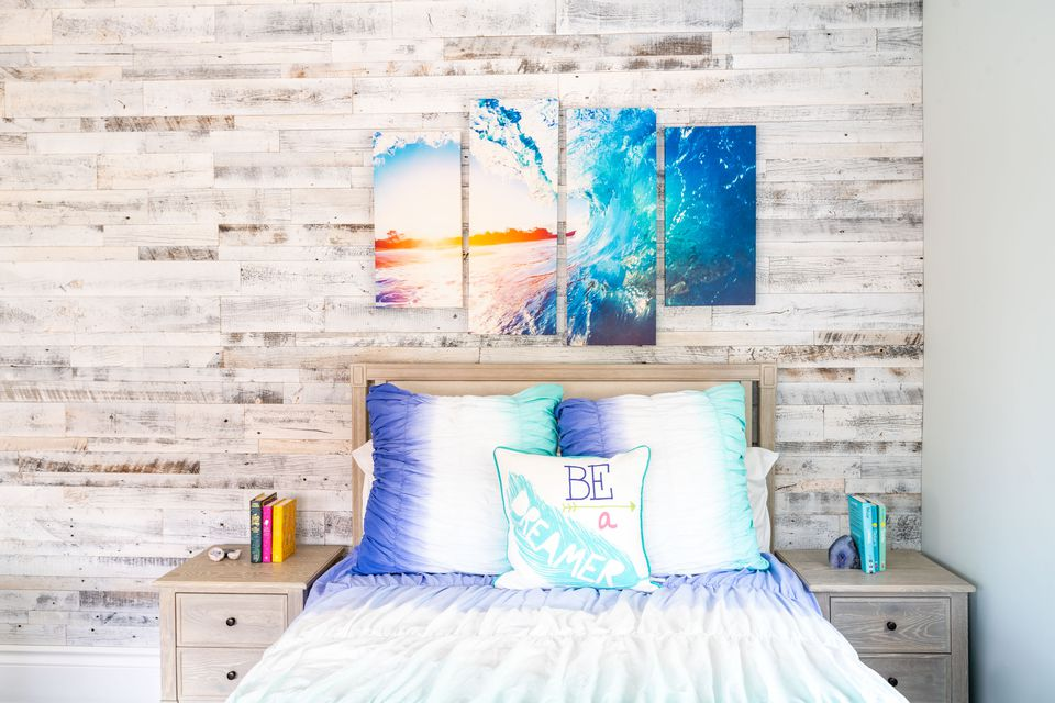 colorful teen bedroom with rustic feature wall