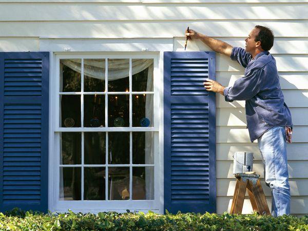 Man Painting vinyl shutters