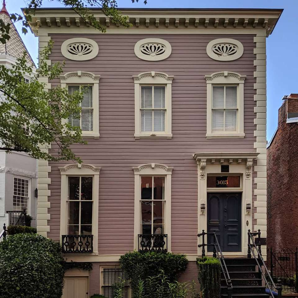 A federal style house with purple walls and ornate windows