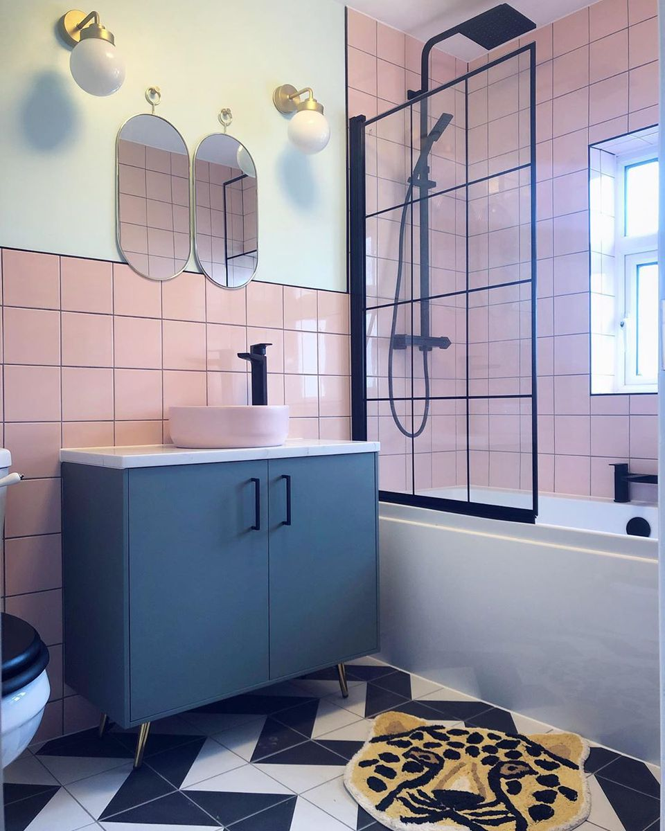 Bathroom with pink tile and black vanity