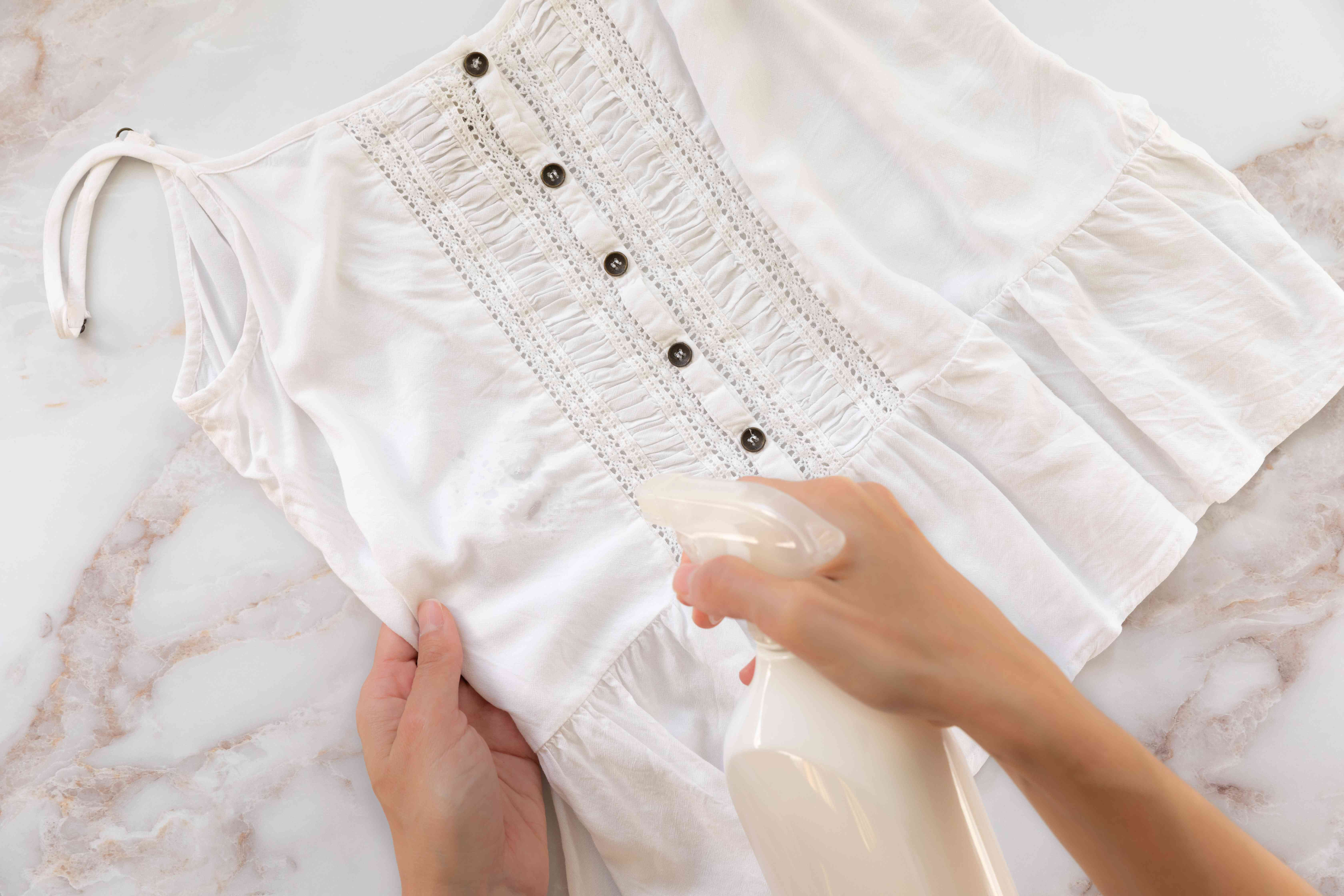Someone pretreating a stain on a rayon garment