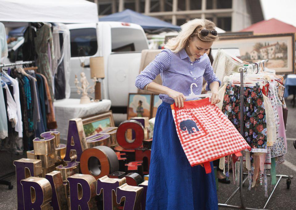 woman shopping at flea market or swap meet