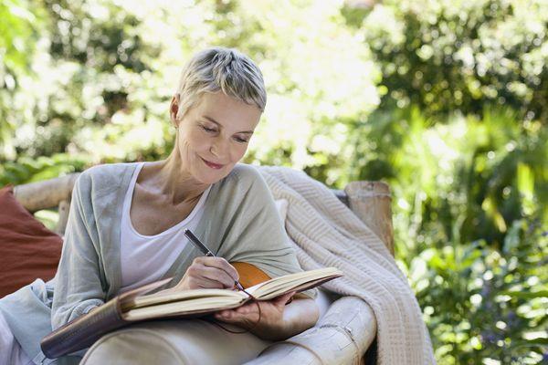 Woman Journaling Outside
