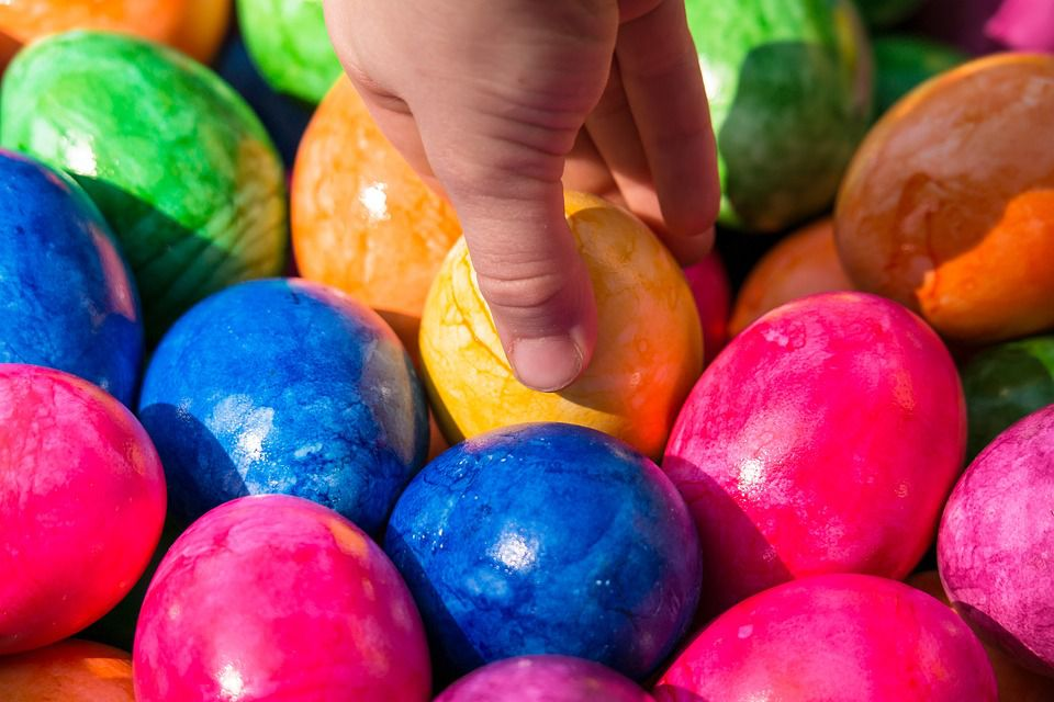 Child picking Easter egg from a batch