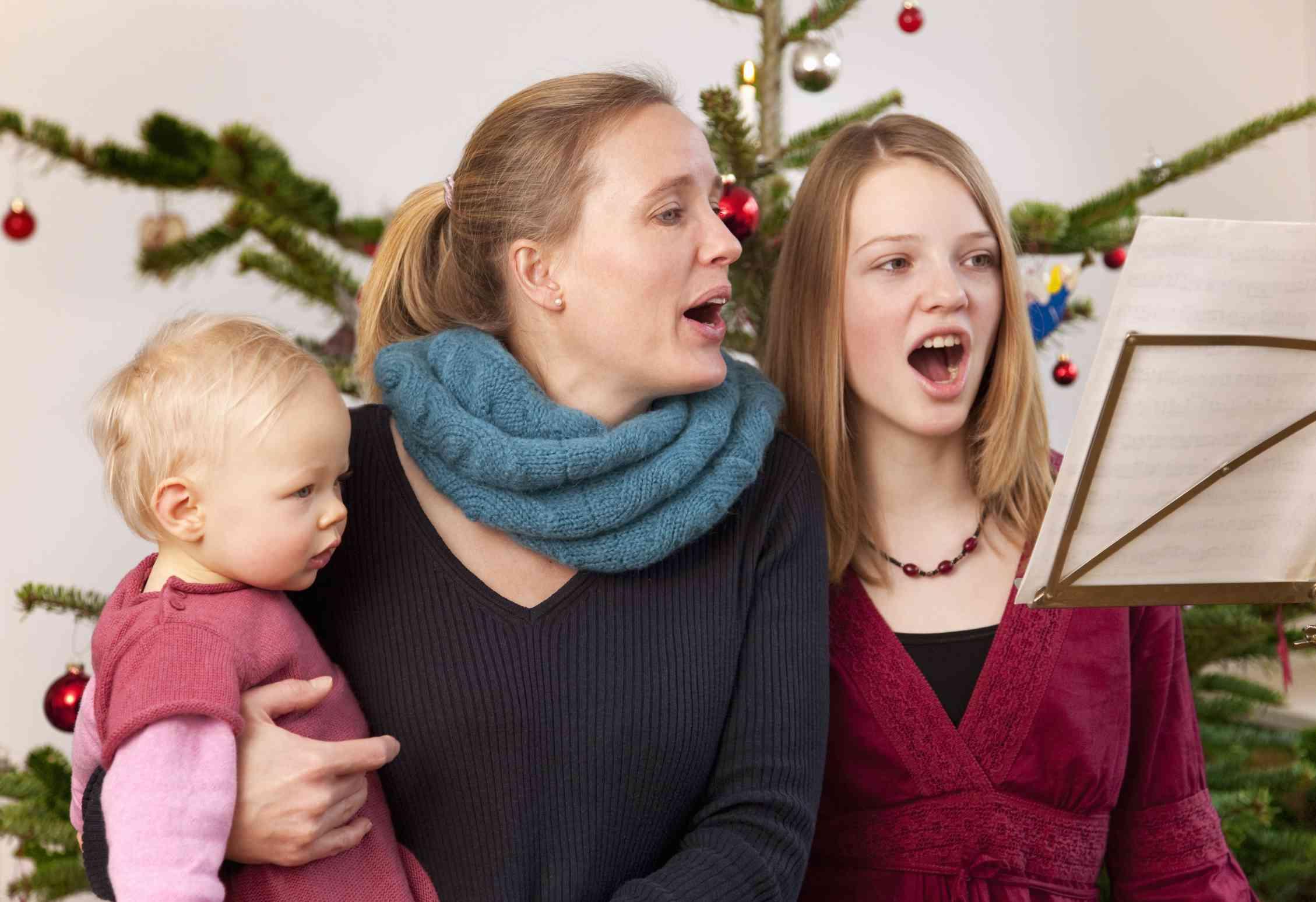 family sining christmas carols together - Family For Christmas