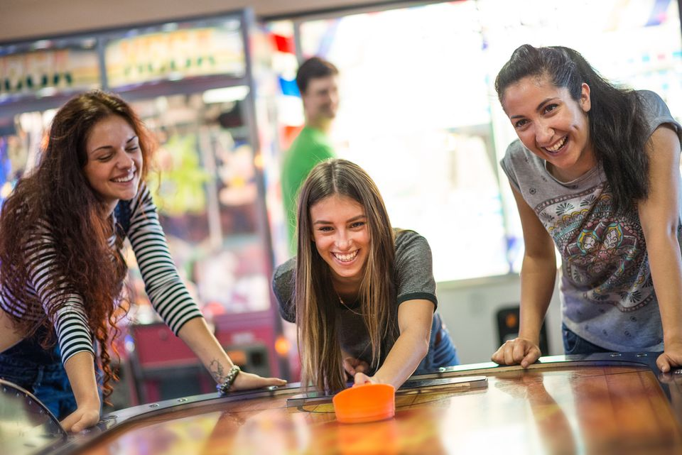 women playing table hockey