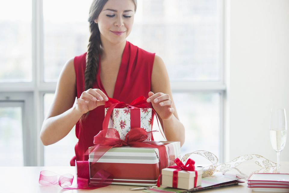 A picture of a woman wrapping presents