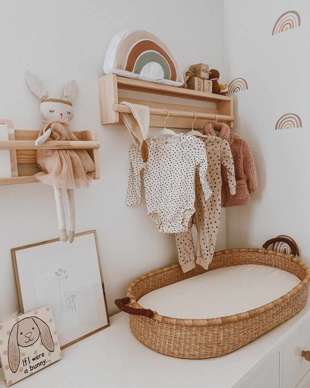 Neutral nursery with clothes hanging