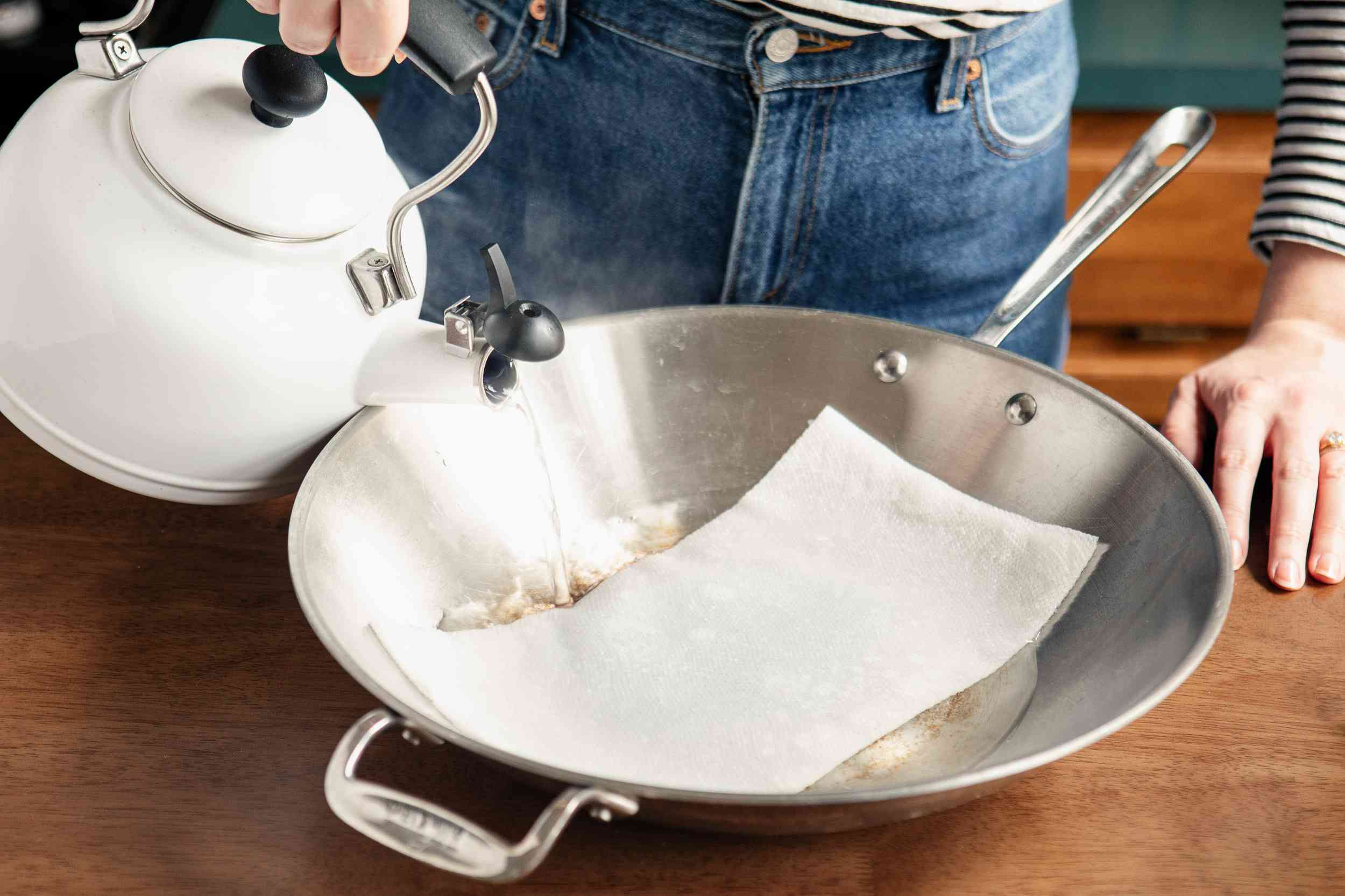 pouring boiling water on the towel