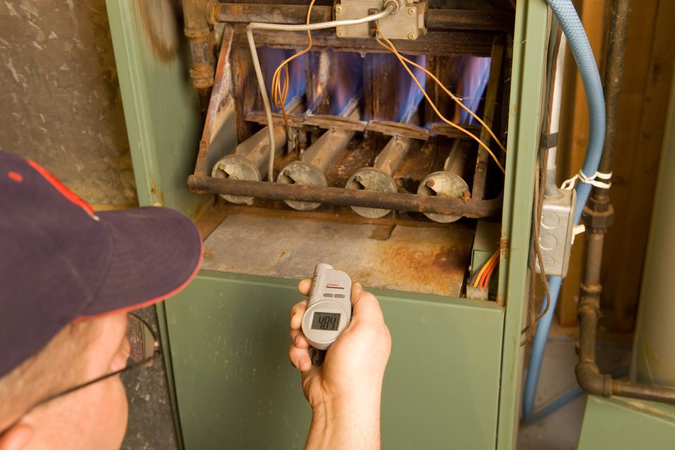 Man working on a furnace